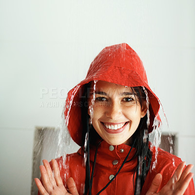 Buy stock photo Woman in rain coat getting rained on indoors