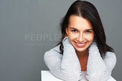 Buy stock photo Woman leaning on shelf with hands at back of her neck