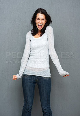 Buy stock photo View of woman clenching her fists and yelling