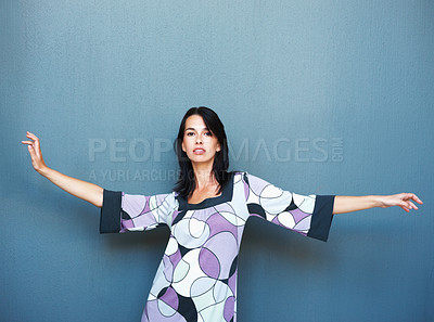 Buy stock photo Attractive woman posing with her arms outstretched