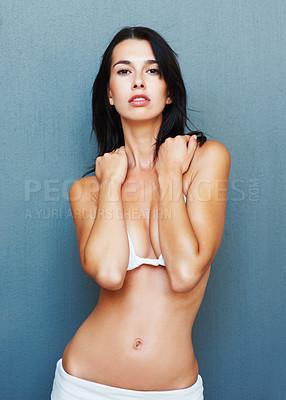 Buy stock photo Portrait of sensuous woman posing on blue background