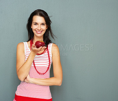 Buy stock photo Smiling young woman holding apple in hand - copyspace