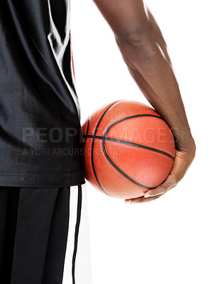 Buy stock photo Rear view of a casual african american guy holding basketball against white background