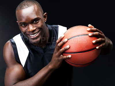 Buy stock photo Portrait of a happy young african basketball player standing against grunge background