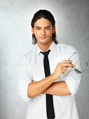 Buy stock photo Man against gray background holding sunglasses