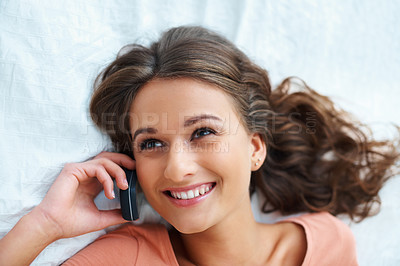 Buy stock photo Cheerful girl listening while on her cell phone