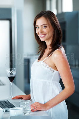 Buy stock photo Portrait of a beautiful young woman standing with laptop in the kitchen at home - Indoor