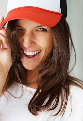 Buy stock photo Sexy woman wearing baseball cap flirting