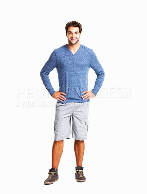 Buy stock photo Full length of a happy young man with hands on hips against white background