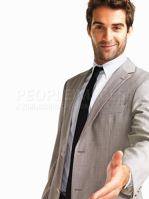 Buy stock photo Confident businessman extending a hand in greeting, isolated on white - copyspace