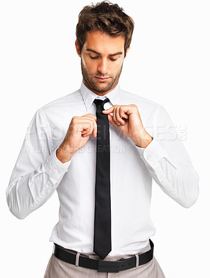Buy stock photo Executive adjusting his tie on white background