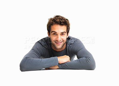 Buy stock photo Casual an lying on floor with arms crossed