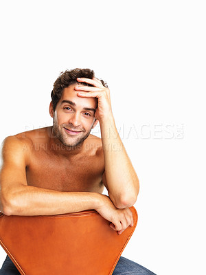Buy stock photo Muscular young man sitting in chair on white background