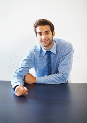 Buy stock photo Portrait of business man leaning on table