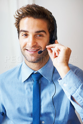 Buy stock photo Closeup portrait of smiling young call center executive with headset looking at you