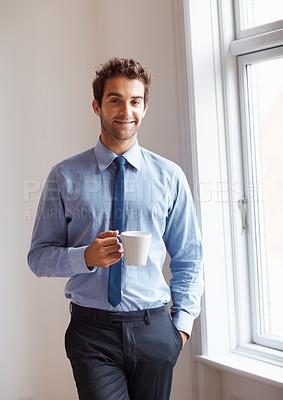 Buy stock photo Executive smiling while on his coffee break