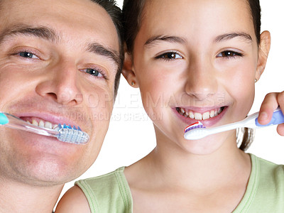 Buy stock photo Closeup portrait of a sweet small girl brushing with her father on white background