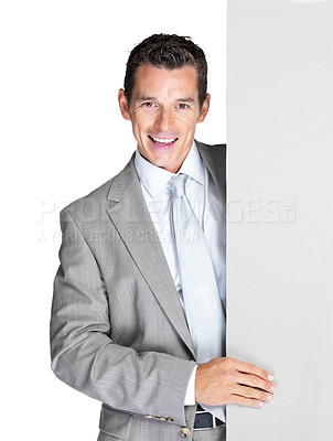 Buy stock photo Portrait of a successful young business man holding an empty billboard against white background