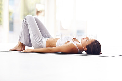 Buy stock photo Portrait of a young fitness woman lying on a yoga mat and exercising