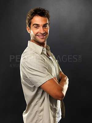 Buy stock photo Portrait of man standing with hands folded and smiling on black background