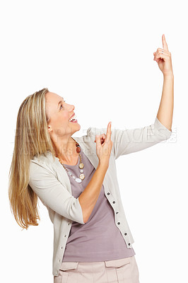 Buy stock photo Portrait of beautiful mature business woman pointing upward on white background