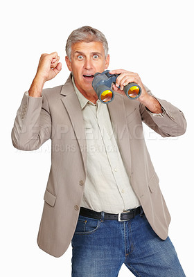 Buy stock photo Studio shot of a mature man cheering while holding binoculars against a white background