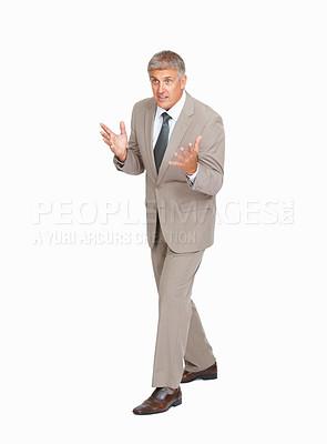 Buy stock photo Studio shot of a mature businessman explaining something against a white background