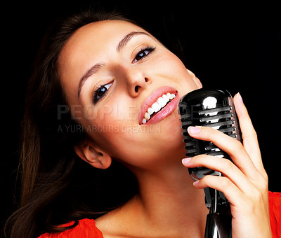 Buy stock photo Closeup portrait of a smiling young female star singer singing with a vintage microphone
