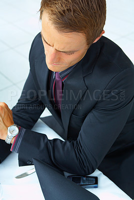 Buy stock photo Businessman at an airport restaurent taking a break