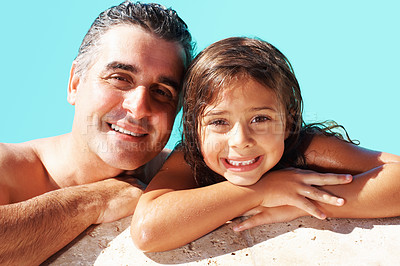 Buy stock photo Closeup of father and daughter relaxing on the edge of swimming pool
