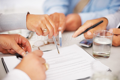 Buy stock photo Group of business people busy discussing financial matter during meeting
