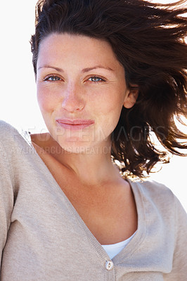 Buy stock photo Closeup portrait of a smiling young female with her hair being blown away by wind