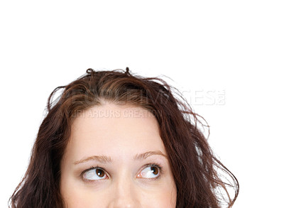 Buy stock photo Cropped image of a cute young lady looking at your product against white background