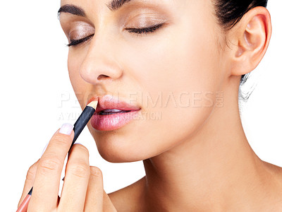 Buy stock photo Closeup portrait of a beautiful young woman applying lipliner