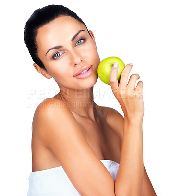Buy stock photo Portrait of a sexy young female holding a green apple against white background