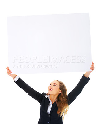 Buy stock photo Portrait of a beautiful business woman holding a blank billboard over her head while looking up at it. Lots of room for text and graphics. This isolate was taken in our studio.