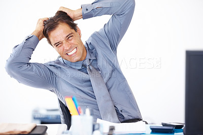 Buy stock photo Portrait of a mature bussiness man pulling his hair in frustration while sitting  at his desk