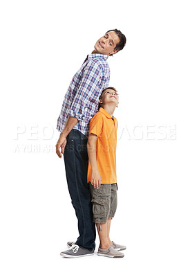 Buy stock photo Potrait of a father and son standing back to back isolated over white background