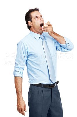Buy stock photo Studio shot of a mature businessman yawning against a white background