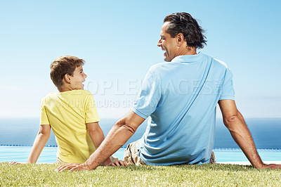 Buy stock photo Rear view of a happy father and small son sitting relax on grass - Outdoor