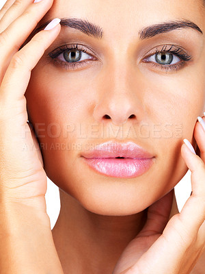 Buy stock photo Closeup portrait of pretty young woman pampering her face with hand