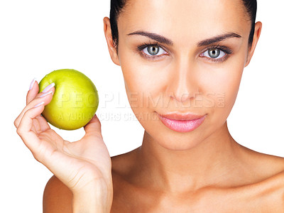 Buy stock photo Portrait of a beautiful young woman holding a green apple in hand against white background