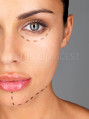Buy stock photo An attractive caucasian woman whose face is marked with lines for facial cosmetic surgery