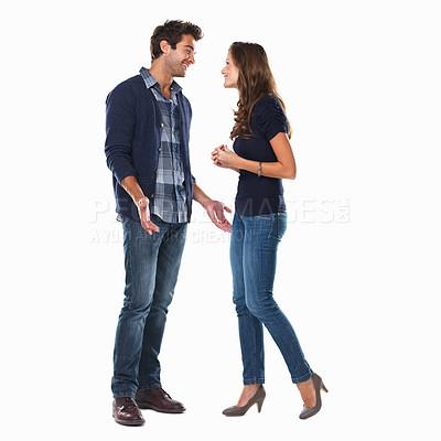 Buy stock photo Studio shot of a couple talking isolated on white