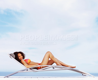Buy stock photo Portrait of a happy sexy woman lying on deck chair and smiling