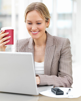 Buy stock photo Close-up portrait of young beautiful smiling business woman drinking coffee and working on her laptop