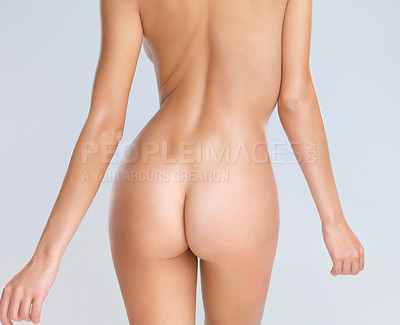 Buy stock photo Rear view of woman's curvaceous butt