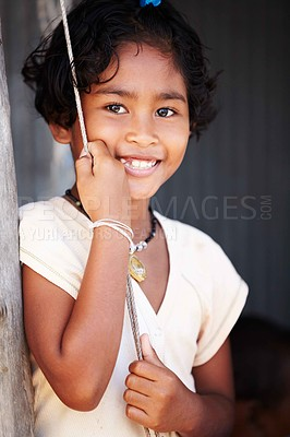 Buy stock photo Closeup portrait of a little girl from rural thailand smiling at you