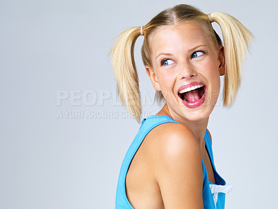 Buy stock photo Cute young woman laughing and smiling isolated on grey - copyspace
