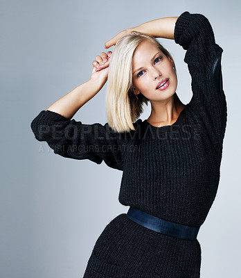 Buy stock photo Pretty young model standing posing while isolated against grey